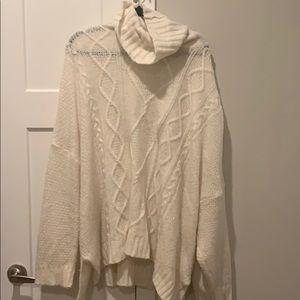 oversized Aerie turtleneck sweater.